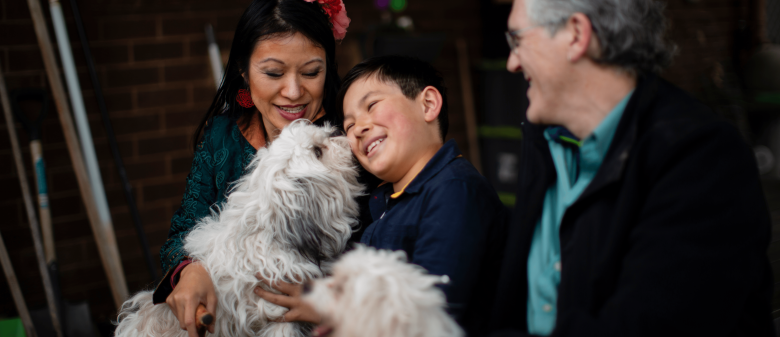 Asian family with a child, puppy and a couple.